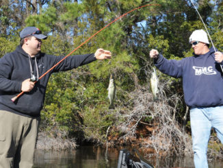 Jason Dew (bow) and Randall Soles catch two largemouth bass at Sutton Lake.