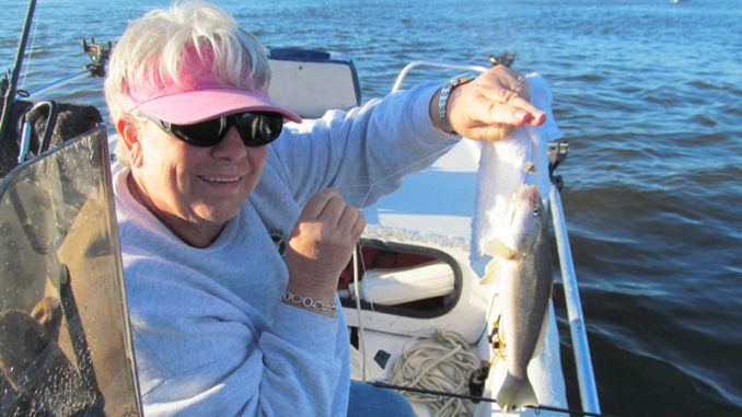 Barbara Foster of Southport, N.C., hoists a tasty, chunky spring whiting.