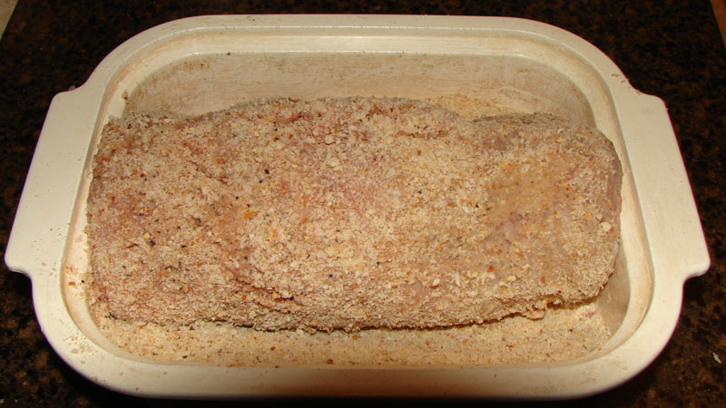 Once stuffed and rolled, the turkey breast is ready to be coated in bread crumbs.