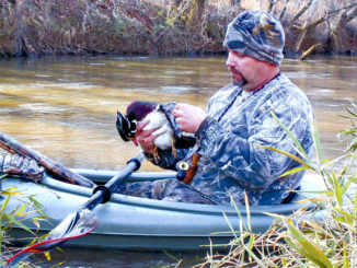 Camouflage that kayak for waterfowl hunting