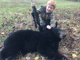 Youth hunter kills his first bear in Henderson County
